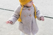 10 warm grey coat, colorful boots and a yellow beanie