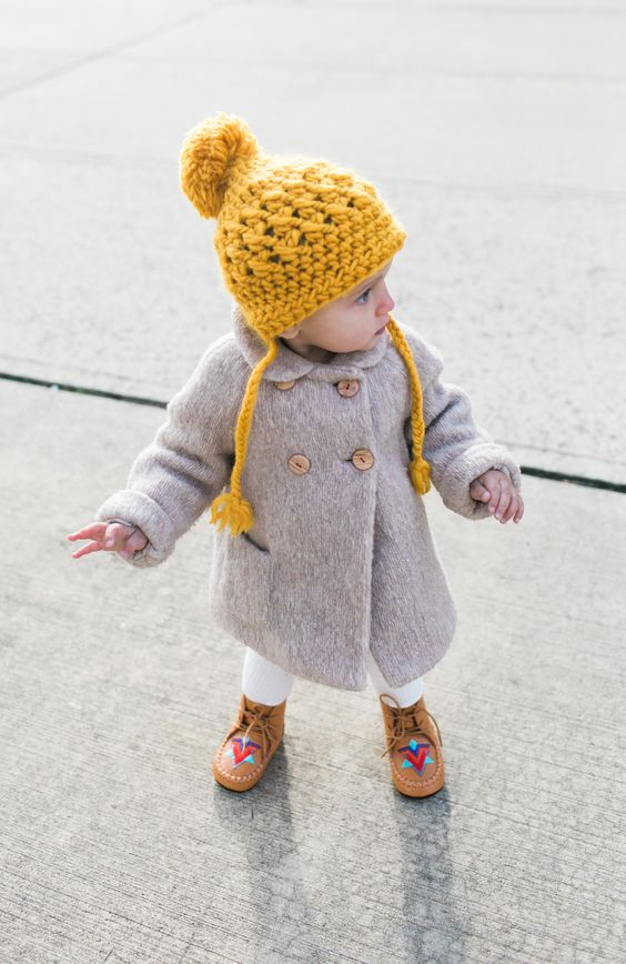 warm grey coat, colorful boots and a yellow beanie