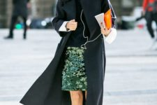 11 a sequined skirt is worn with a collared shirt, sweater, a duster coat, and sneaks