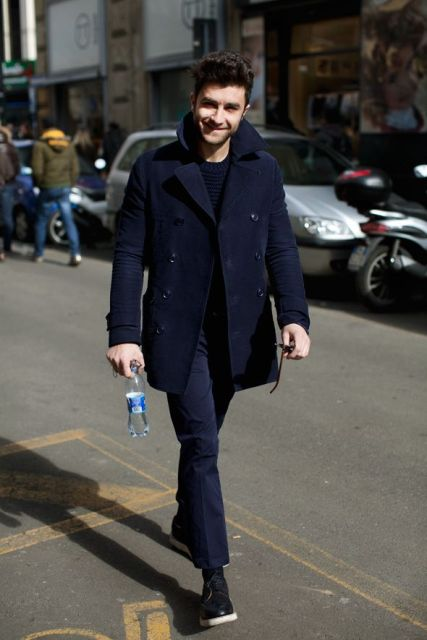 a smart casual look with a navy coat and pants, black shoes