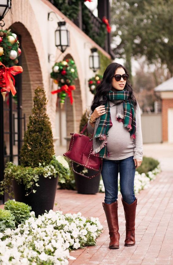 jeans, a neutral jersey, a plaid scarf and knee cognac boots