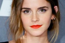 11 orange lips can be a great take on a traditional bold lip look