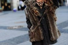 12 a fur coat, a knit black dress, leopard tights and faur ugg boots