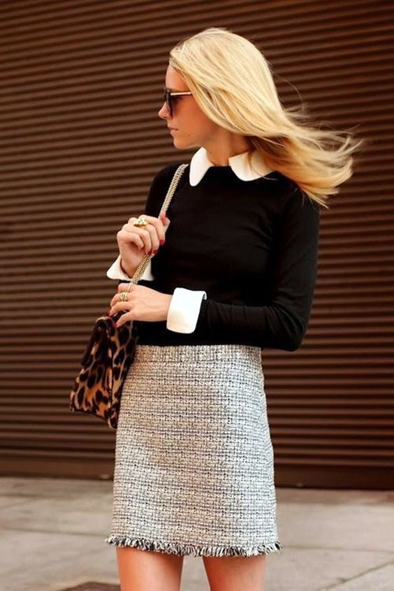 a tweed mini skirt, a button down shirt and a black jersey