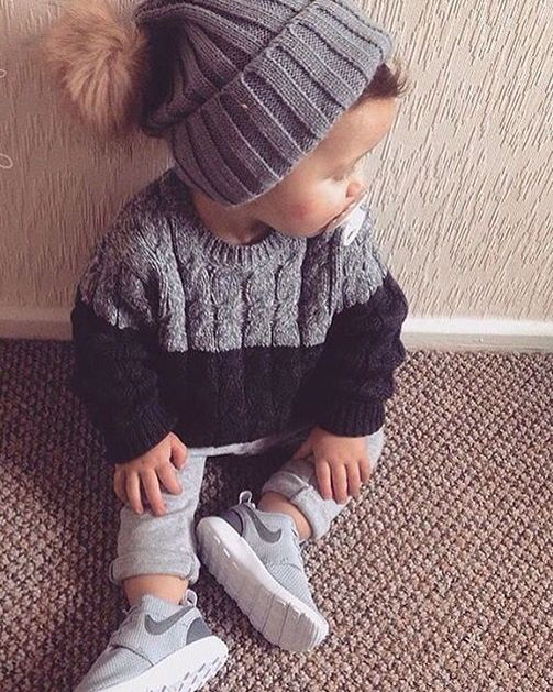grey pants, a cable knit sweater, Nike, a beanie
