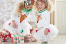 12 striped leggings, tutu skirts, shirts with deer and bold headbands