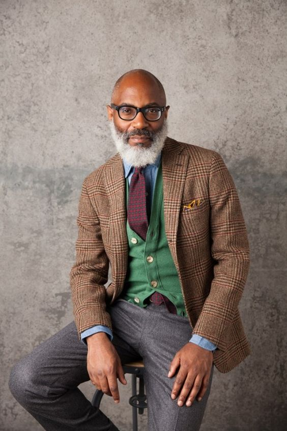 a bold look for a creative job   a tweed jacket, a green vest and grey pants