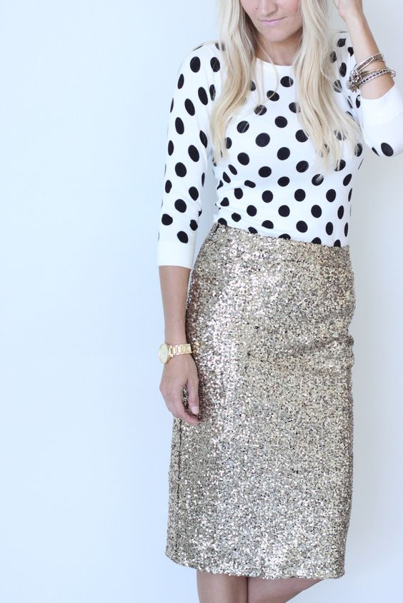 a gold midi skirt with a polka dot sweater