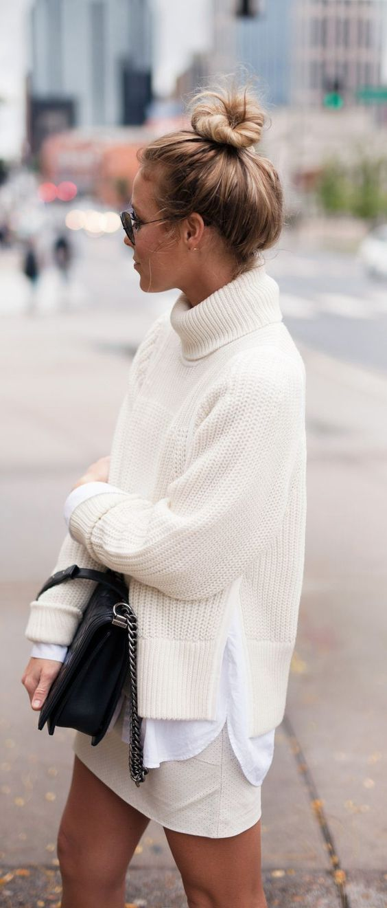 an ivory skirt, a crispy white shirt and an ivory chunky sweater