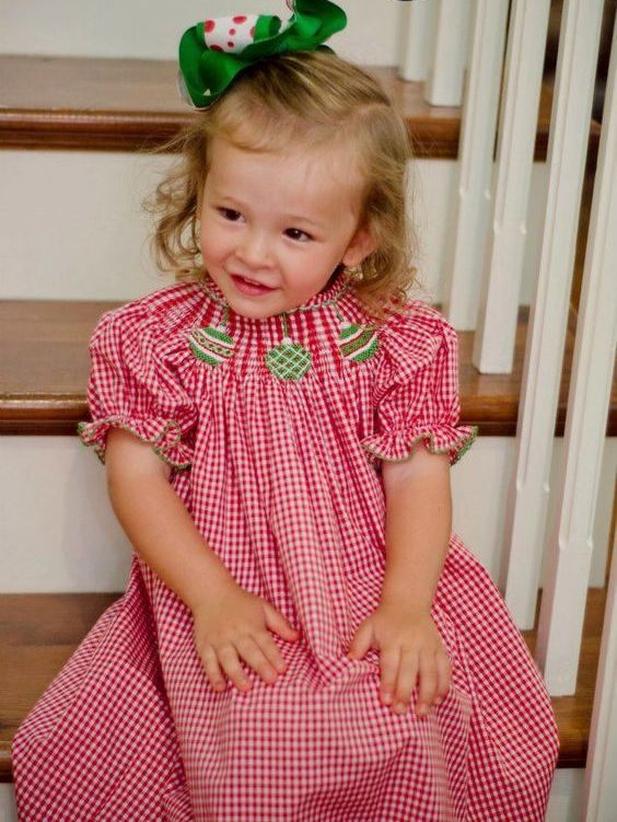 red and white gingham dress with embroidered green ornaments