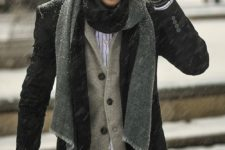 14 a black jacket and pants, a grey cardigan, a scarf and a beanie