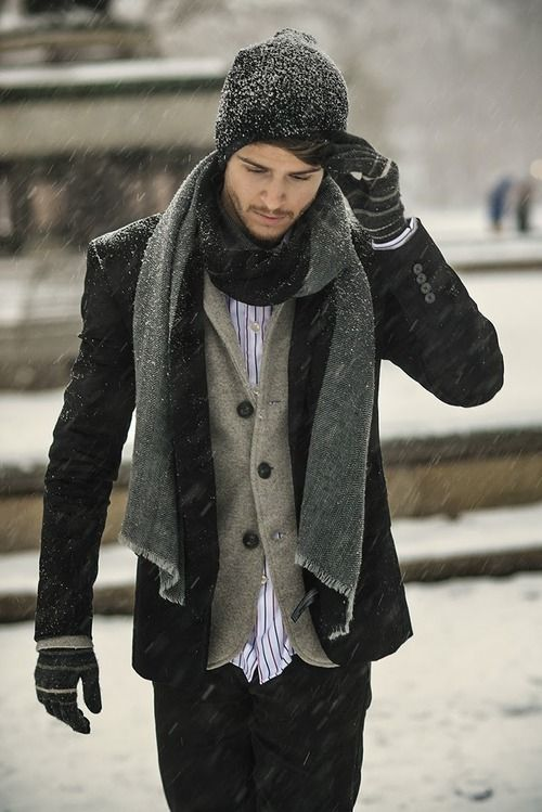 a black jacket and pants, a grey cardigan, a scarf and a beanie