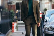 14 a brown suit with an emerald turtleneck