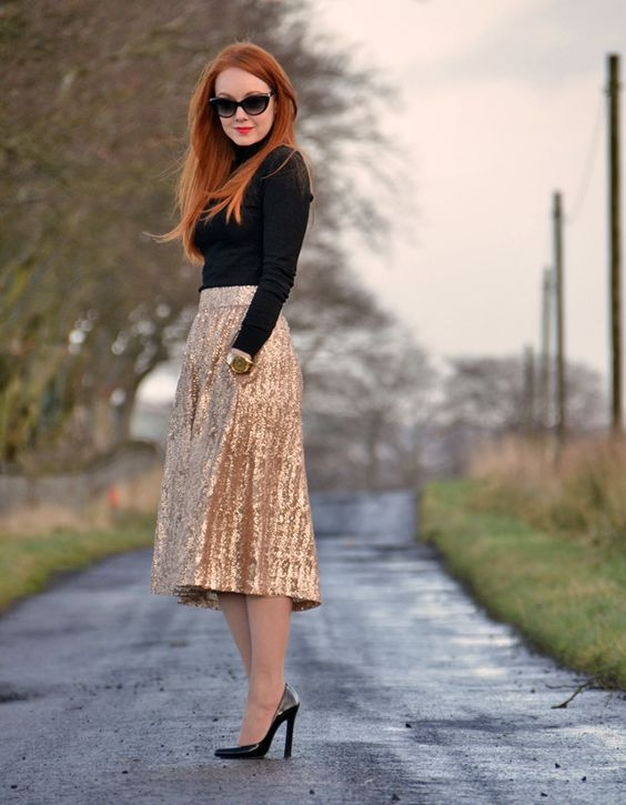 a gold sequin midi, a black turtleneck sweater and heels