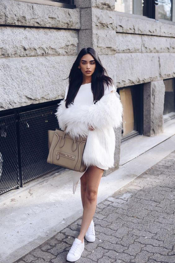 a white sweater dress, a fur coat and sneakers
