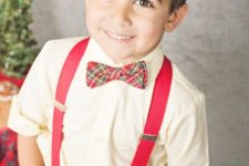 14 jeans, an ivory shirt, red suspenders and a plaid bow tie