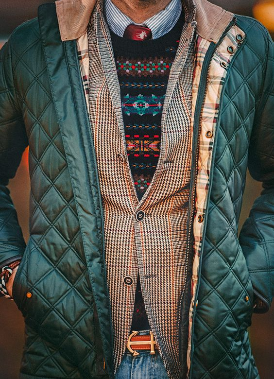 multi-layered look with a shirt, a sweater, a tweed jacket and a puffed jacket