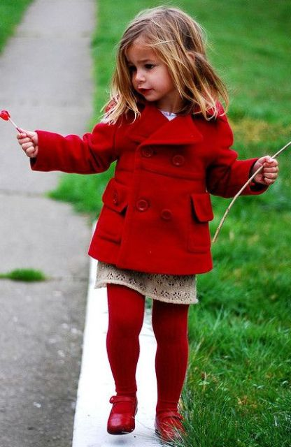 red tights and shoes, a red coat and a lace dress
