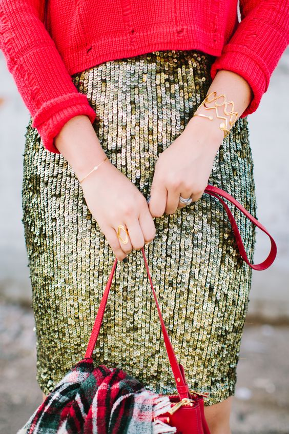 a gold sequin skirt and red sweater