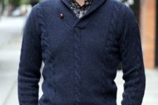 15 a navy wool shawl pullover, a plaid shirt and grey trousers