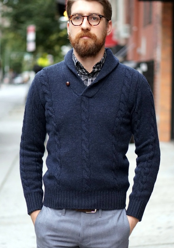 a navy wool shawl pullover, a plaid shirt and grey trousers