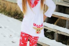 15 a white shirt with a reindeer, Scandi-inspired red leggings and a scard and fur boots