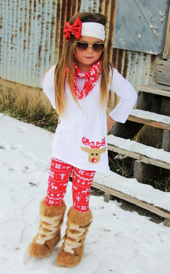 a white shirt with a reindeer, Scandi-inspired red leggings and a scard and fur boots