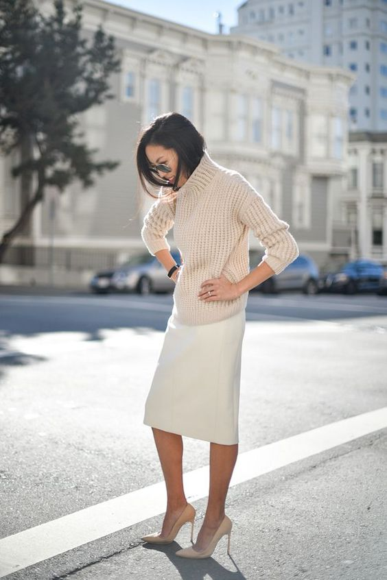 an ivory skirt, a nude chunky knit sweater and heels