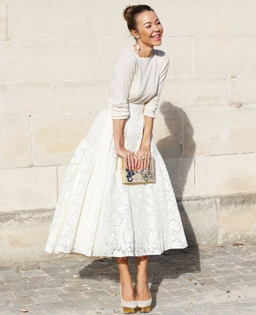 an ivory sweater and a white lace skirt for a refined and girlish look