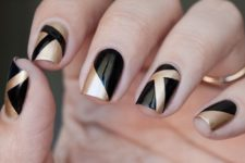 15 black and gold nails with geometric patterns