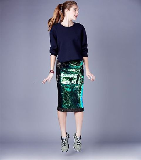 a green sequin skirt, a navy sweater and sneakers for a modern look