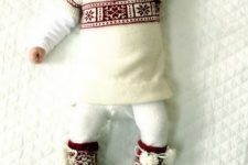16 an ivory and red patterned sweater, white leggings, red socks with pompoms