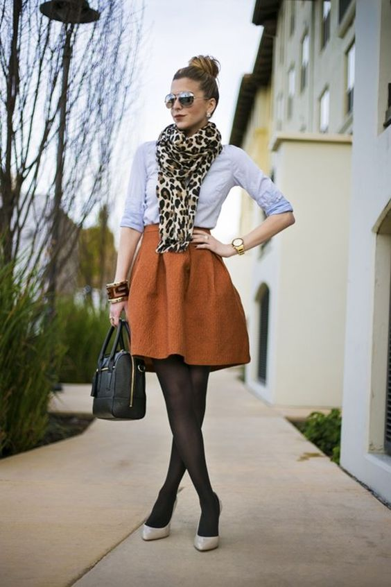 an orange skirt, a serenity blue shirt, ivory shoes and a leopard scarf