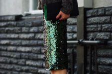 17 a grey chunky knit sweater, a green sequin midi and pumps