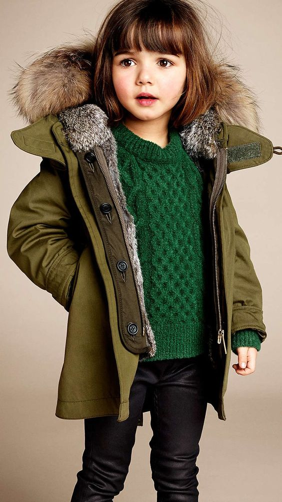 black jeans, an emerald sweater, an olive green coat with fur