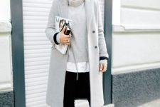 17 black pants, a grey sweater, a white shirt and a grey coat