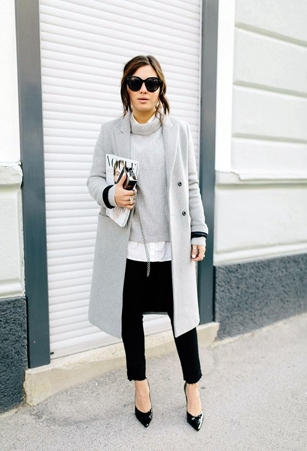 black pants, a grey sweater, a white shirt and a grey coat