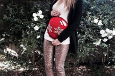 17 sequin pants, a printed shirt, a black cardigan, lace up heels and a red beanie