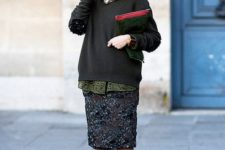 19 a slouchy sweater and dark green sequin skirt