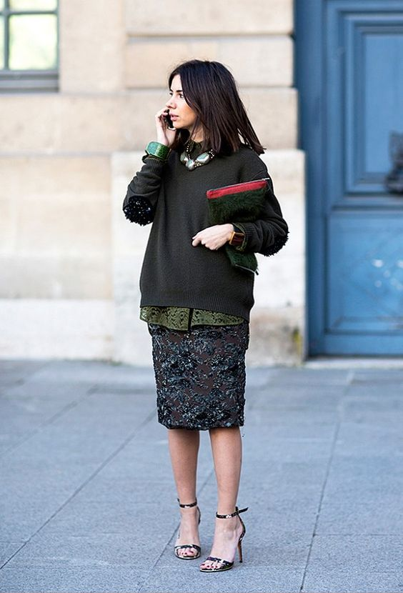 a slouchy sweater and dark green sequin skirt