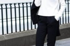 19 black pants, a white sweater and flats is monochrome classics