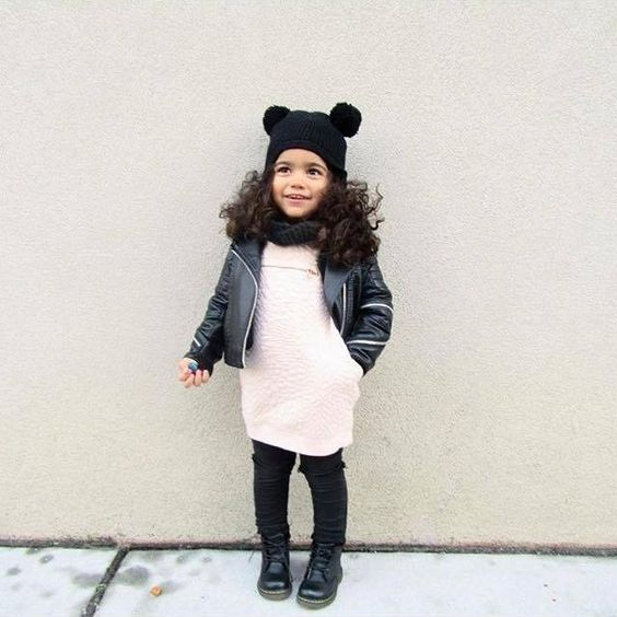 comfy white dress, pants, a leather jacket, a cowl and a beanie with pompoms
