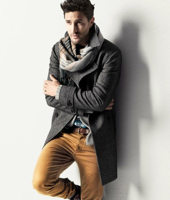 ocher pants, a twweed grey coat and a plaid scarf