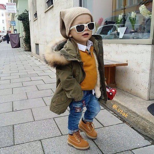 jeans, ocher boots and a sweater, an olive green parka and a beanie