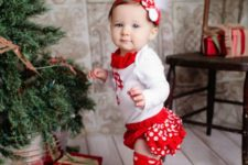 20 polka dot red leg warmers, a white shirt with ruffles and a headband for the smallest ones