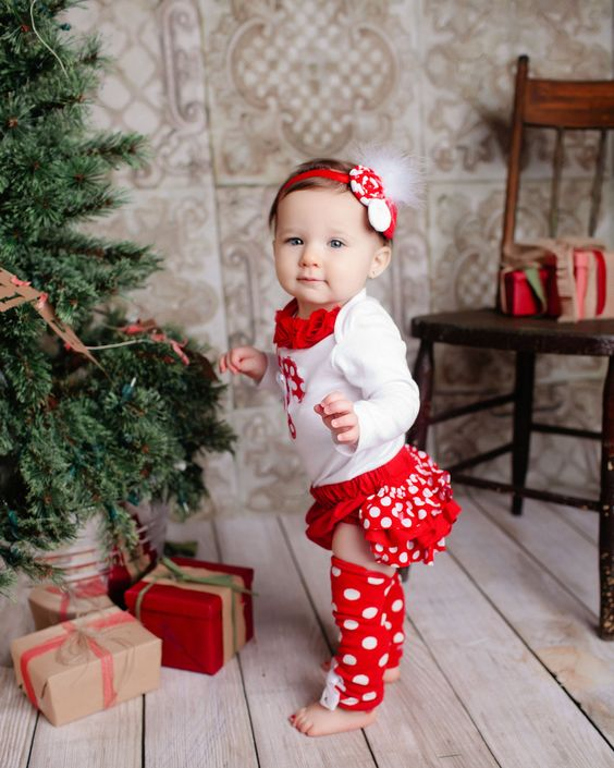 polka dot red leg warmers, a white shirt with ruffles and a headband for the smallest ones