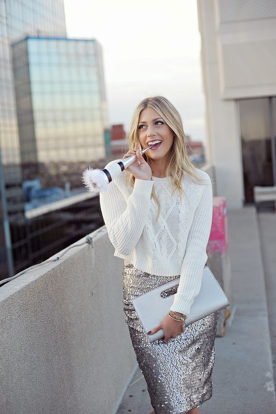 a white crop sweater and a sequin midi
