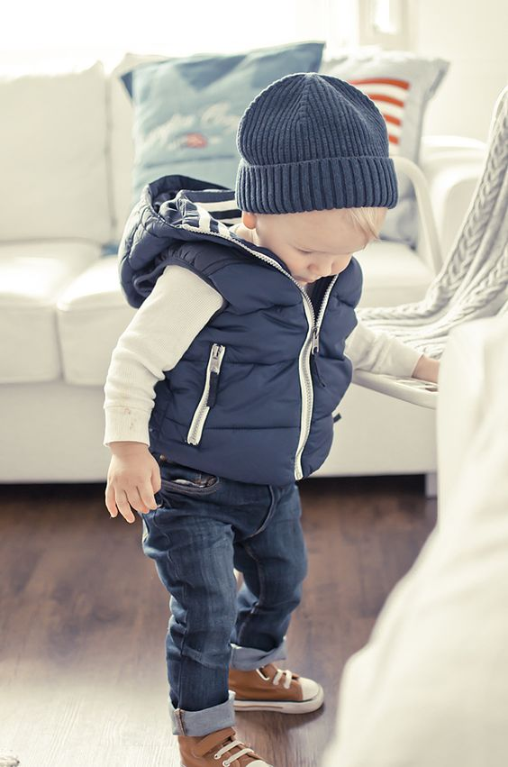 stylish boy's outfit with ocher chucks, jeans, a quilted vest and a beanie