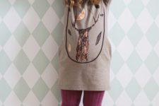 21 purple tall suede boots and tights of the same shade, a neutral dress with a tree printed