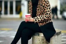 21 total black look with pants, a turtleneck sweater and heels and an animal print coat
